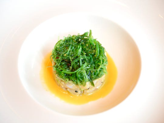 A little puck of Hamachi Tartare comes crowned with a tuft of seaweed salad.