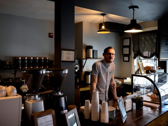 Ryan Vaxmonsky, co-owner of Evermore Coffee Roasters, stands behind the counter of his shop on Union St Wednesday, May 2, 2018 in Burlington, N.J. Ryan and his wife Lauren Vaxmonsky opened in Aug. 2017.