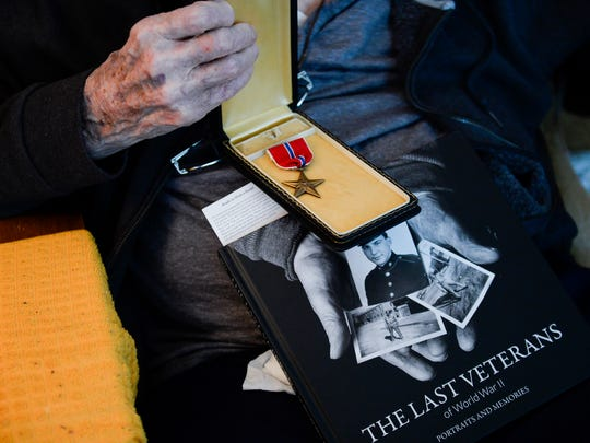 Retired Army Lt. Col. John 'Jake' Parvin, who will turn 100 next month, displays his bronze star inside his home in Pennsauken, N.J. Friday, May 4, 2018.
