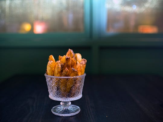 Don't skip the salty side of za'atar-spiced fries, served with toum, a creamy garlic sauce, for dunking.