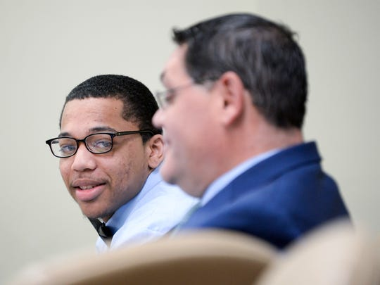 Tyhan Brown, left, appears in court alongside defense attorney Adam Brent Thursday, June 7, 2018 at Camden County Hall of Justice in Camden, N.J. Brown, 20, is accused of shooting Gabby Hill-Carter as the 8-year-old played on a city street in August 2016.