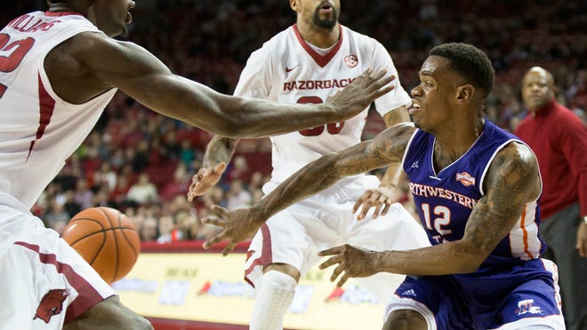 Northwestern State guard Jalan West (12) makes a pass through the Arkansas defense during a 100-95 Razorbacks victory last season. West and the Demons will return to Fayetteville, Arkansas, on Dec. 1 for one of the Demons' five games against Power 5-conference schools.