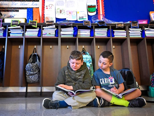 Elijah Stamper and Mason Cross read in the third grade