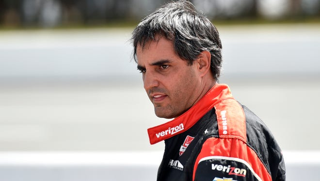 Juan Pablo Montoya, of Colombia, stands on pit road during qualifying for Sunday's Pocono IndyCar 500 auto race, Saturday, Aug. 22, 2015, in Long Pond, Pa.