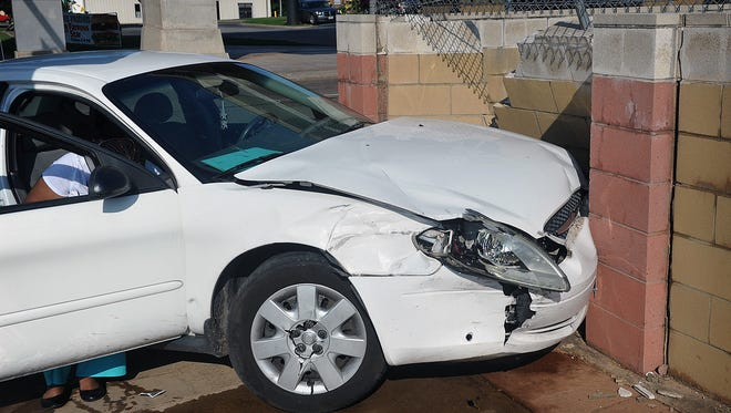 A Ford Taurus crashed into a cinder block wall after colliding with a taxi cab Tuesday morning at the intersection of Broad and 14th Street. There were no serious injuries in the accident.
