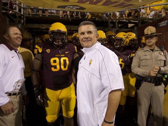 Todd Graham looks out at the field before his coaching