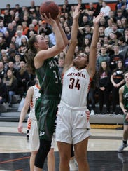 Grinnell Tiger Sienna Durr, 34, tries to block a shot