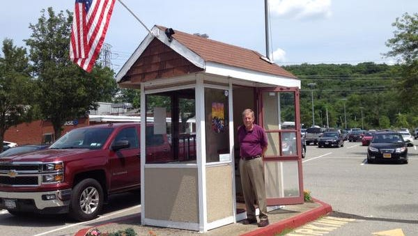Michael Baker stands in the entrance to the Entrepreneur's Shack in the Millwood Plaza, at the corner of Route 100 and 133 in Millwood.