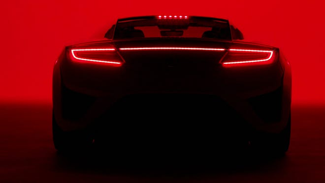 An Acura NSX is profiled in the brand's new Super Bowl commercial