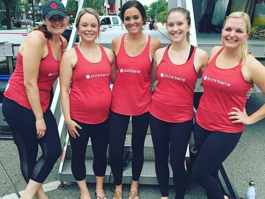 Pure Barre instructors, from left, Rose Schulist, Jaclyn Baack, Carmen Crapo, Bridget Amodeo and Amy Smith led the free class Wednesday. Studio owners Liz Hynes and Becky Lictawa hope to open Pure Barre Plymouth in October.