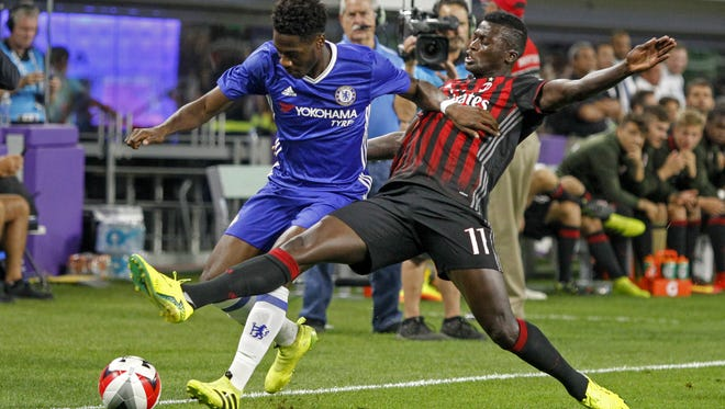 Chelsea's Ola Aina, left, battles with AC Milan's Niang Mbaye for the ball Aug. 3 at U.S. Bank Stadium, the first professional sporting event held at the Minnesota Vikings' new building.
