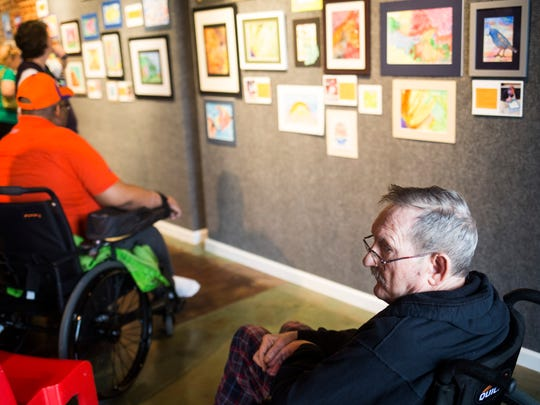 Ralph Swanson shows his work at an art exhibit of original watercolors created by local senior citizens through a program called Senior Studio on Tuesday, September 27, 2016 at the Anderson Arts Center.