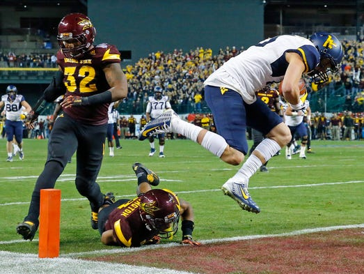 West Virginia Mountaineers' David Sills leaps into