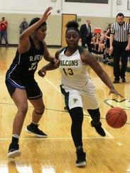 Groves senior Kayla Nelson (13) provides strong guard