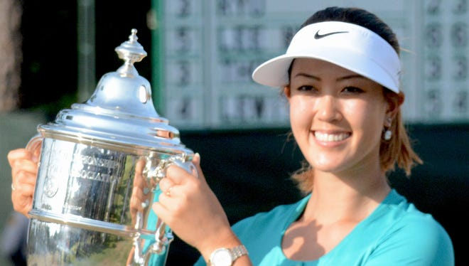 Michelle Wie poses with the Harton S. Semple trophy aftger winning the U.S. Women's Open at the Pinehurst Resort and Country Club-#2 Course.