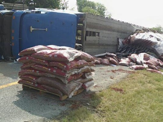 A tractor-trailer overturned and spilled bags of mulch along Route 30 eastbound near Route 462, west of York, on Tuesday.