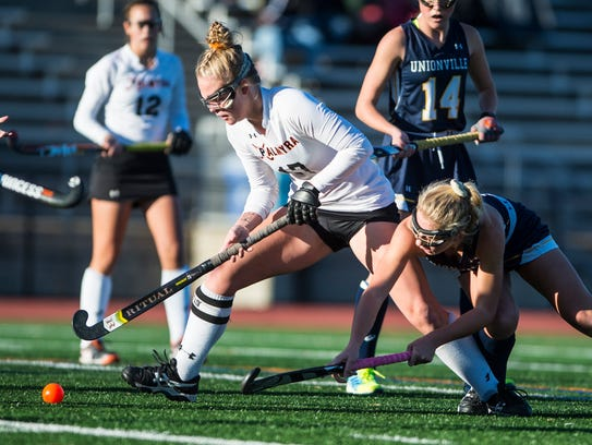 Katelyn Mark, Palmyra, fights off Unionville's Claire