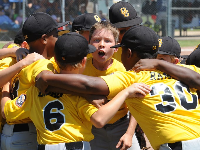 Barrett Breazeale (11), center, leads the Oak Grove 9U All Stars in a team chant before they play Vancleave on Friday.