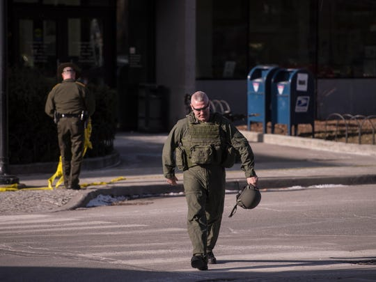 Vermont State Police bomb squad officers break down after inspecting materials from a bag found outside the Federal Building at the corner of Peal Street and Elmwood Ave. in downtown Burlington on Friday morning, Jan. 6, 2017.