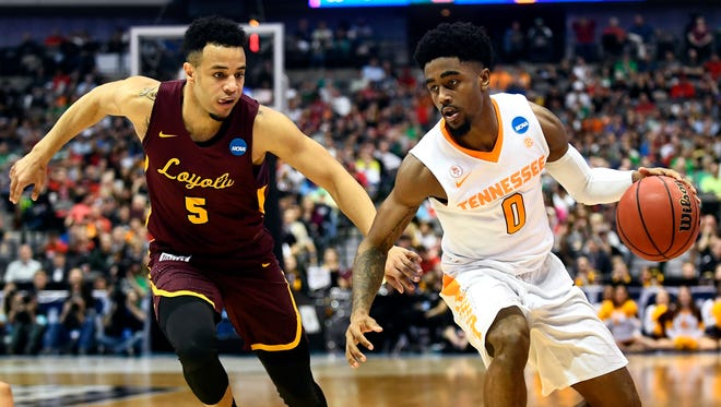 Tennessee guard Jordan Bone (0) drives past Loyola Chicago guard Marques Townes (5) during Saturday's game.