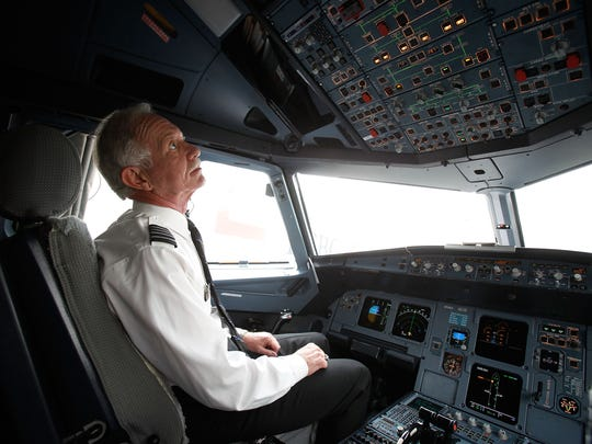"""Capt. Chesley """"Sully"""" Sullenberger, who landed US Airways Flight 1549 on the Hudson River on Jan. 15, 2009, sits in the cockpit of a US Airways plane at LaGuardia Airport on Oct. 1, 2009."""