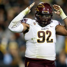 Sep 13, 2014: Arizona State Sun Devils nose tackle Jaxon Hood (92) reacts after making a tackle during the first half against the Colorado Buffaloes at Folsom Field .