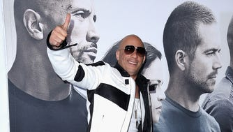 "Actor Vin Diesel attends Universal Pictures' ""Furious 7"" premiere at TCL Chinese Theatre on April 1, 2015 in Hollywood, California."