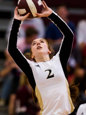 T.L. Hanna's Gabby Easton sets the ball in a match earlier this year.
