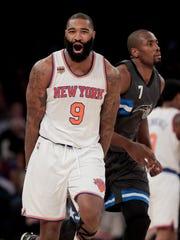 New York Knicks center Kyle O'Quinn (9) reacts after