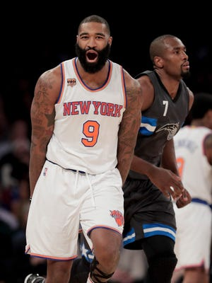 New York Knicks center Kyle O'Quinn (9) reacts after scoring against the Orlando Magic during Thursday's game.