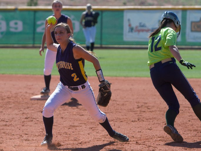 Enterprise's Kaylee Christensen fires the ball on to first base for a double play after tagging out Snow Canyon baserunner Lauren Smith Monday, April 28, 2014.