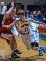 Harper Creek's Jeremiah Davis (11) drives to the basket