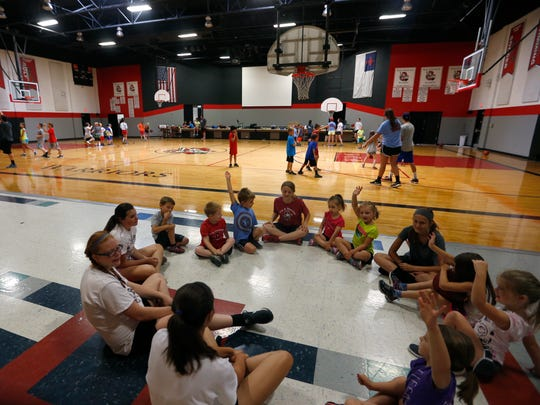 Students participate in activities at a sports camp