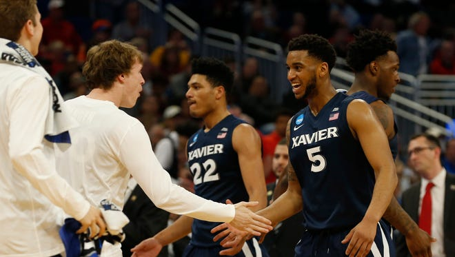 Xavier Musketeers guard Trevon Bluiett celebrates with teammates after defeating the Maryland Terrapins in the first round of the NCAA Tournament at Amway Center.