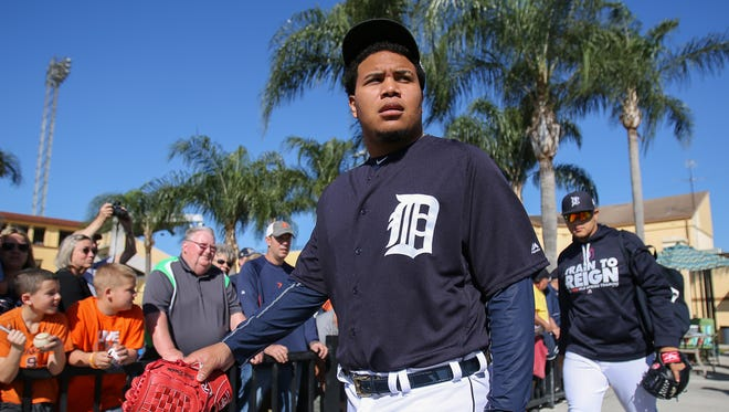 Tigers pitcher Bruce Rondon walks out of the clubhouse past fans during Detroit Tigers spring training at Joker Marchant Stadium in Lakeland, Fla. on Friday, Feb. 19, 2016.