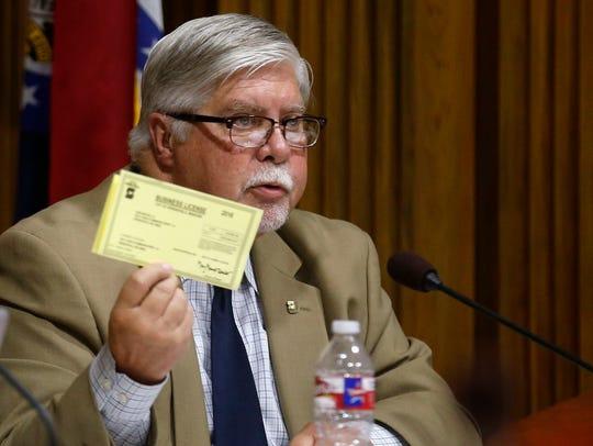 Springfield Mayor Bob Stephens hold up his business