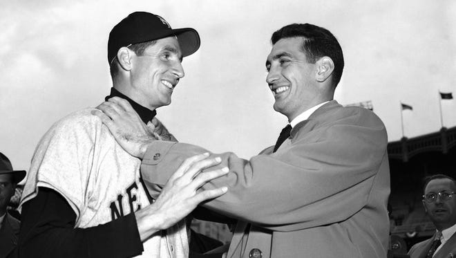 In this Oct. 10, 1951, file photo, Bobby Thomson, left, of the New York Giants and Ralph Branca of the Brooklyn Dodgers engage in horse play before a World Series game at Yankee Stadium in New York.
