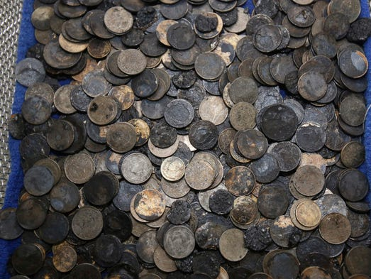 A pile of coins removed from Bank after her surgery.