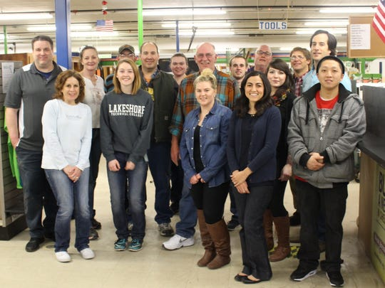 New employees of Sargento Foods pose for a photo after volunteering at the Habitat for Humanity Restore in Sheboygan on Monday, March 6.