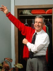 "Fred Rogers, the host of ""Mister Rogers' Neighborhood,"" gets ready for work in this 1995 photo."