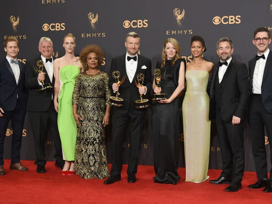 "The cast and crew of ""Black Mirror: San Junipero"" pose in the press room with their awards for for outstanding television movie at the 69th Primetime Emmy Awards on Sunday, Sept. 17, 2017, at the Microsoft Theater in Los Angeles."