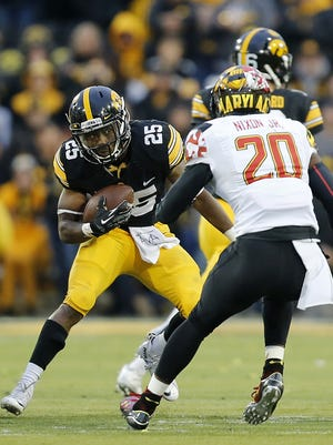 Iowa's Akrum Wadley cuts ahead for some of his 67 yards vs. Maryland.