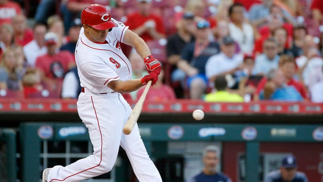 Cincinnati Reds second baseman Jose Peraza (9) singles to left-center field in the bottom of the second inning of the MLB National League game between the Cincinnati Reds and the San Diego Padres at Great American Ball Park in downtown Cincinnati on Tuesday, Aug. 8, 2017.