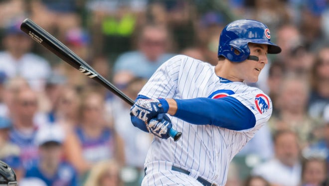 Chicago Cubs first baseman Anthony Rizzo (44) hits an RBI single during the sixth inning against the Arizona Diamondbacks at Wrigley Field.