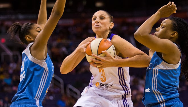 Phoenix Mercury guard Diana Taurasi drives to the hoop for two against the Minnesota Lynx during first quarter action , Wednesday, June 18, 2014, at U.S. Airways Center in Phoenix.