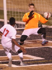 Brownwood goalie Caleb Woodcock, right, makes a stop on a shot by Cooper's Sylva Uwimana (17) in the first half. Woodcock made 10 saves in the half and 16 overall, but the Cougars beat the Lions 4-1 in the nondistrict game Friday, Jan. 26, 2018 at Shotwell Stadium.