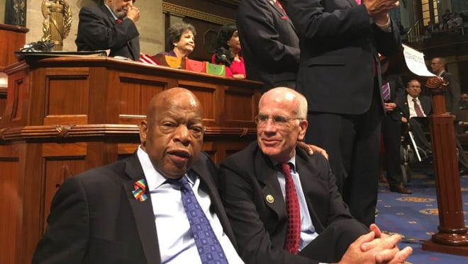 U.S. Rep. Peter Welch, D-Vt., seated at right, joins other Democrats including Rep. John Lewis, D-Ga., left, in a sit-in that stretched overnight from Wednesday to Thursday, June 23, 2016, on the House floor in Washington to protest inaction on gun legislation.