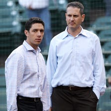 Mar 28, 2013; Arlington, TX, USA; Texas Rangers general manager Jon Daniels (left) and assistant general manager Thad Levine talk before the game against the Mexico City Red Devils at the Rangers Ballpark. Mandatory Credit: Jim Cowsert-USA TODAY Sports