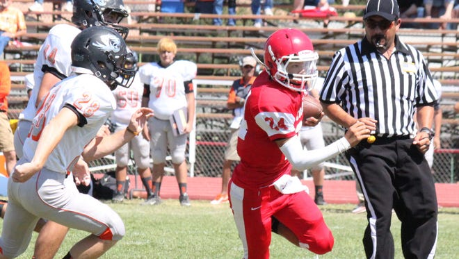 Cobre quarterback Andru Sanchez has shown a lot of patience in the pocket. He only leaves when there's no chance of throwing the football and can scamper with the best of them in the open field.