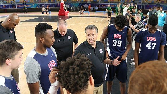 Team USA head coach John Calipari leading his team